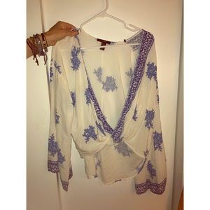 Patterned blue and white floral blouse